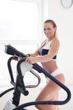 Smiley blonde woman on treadmill Stock Photos