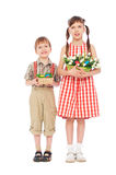Smiley boy and girl with easter gifts. Isolated on white Stock Images