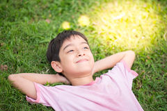 Free Smiley Boy Laying Down In The Park Stock Photography - 64608512