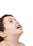 Smiley boy looking up, isolated Royalty Free Stock Image
