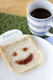 Smiley bread and coffee. With morning note for breakfast Stock Image