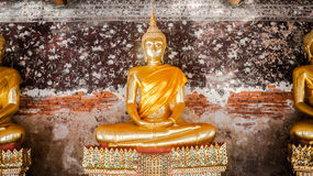 Smiley buddha statue. Has an ancient flower paintings and bricks are background,  Wat Suthat Thepwararam Bangkok Thailand, Historical place and Public place Stock Image