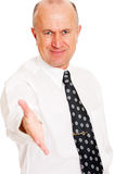 Smiley business man ready for a hand shake Stock Images