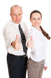 Smiley business people showing thumbs up Royalty Free Stock Photography