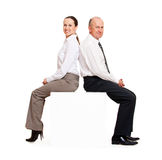 Smiley business people sitting on the copyspace Royalty Free Stock Photos