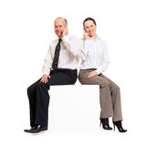 Smiley business people with telephones Royalty Free Stock Photos