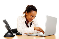 Smiley business woman typing on computer Stock Photo