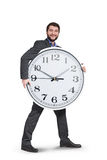 Smiley businessman with big clock Royalty Free Stock Photos