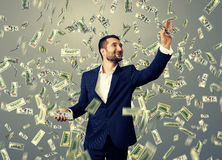 Smiley businessman catching money Royalty Free Stock Image