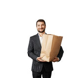 Smiley businessman holding paper bag Stock Photography