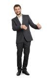 Smiley businessman holding something Stock Photo