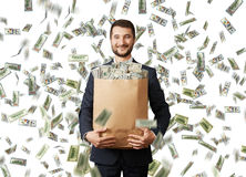 Smiley businessman with money Stock Images