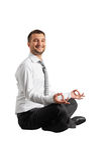 Smiley businessman practicing yoga Stock Image