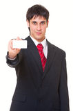 Smiley businessman showing business card Royalty Free Stock Images