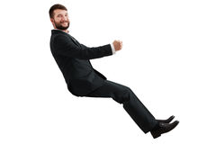 Smiley businessman sitting Royalty Free Stock Photo