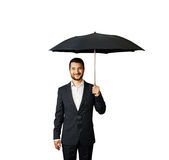 Smiley businessman under umbrella Royalty Free Stock Photography