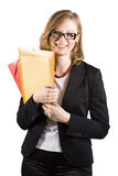 Smiley businesswoman with colored folders Stock Image