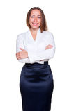 Smiley businesswoman with crossed hands Royalty Free Stock Image