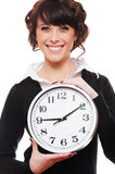 Smiley businesswoman holding clock Stock Photos