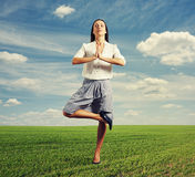 Smiley businesswoman meditation. On the green field Royalty Free Stock Image