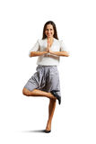 Smiley businesswoman practicing yoga Stock Images