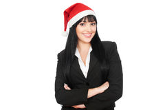 Smiley businesswoman with red santa hat Stock Photos