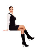 Smiley businesswoman sitting Stock Photography