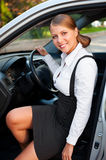 Smiley businesswoman sitting in the car Royalty Free Stock Image