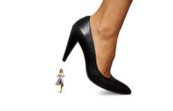 Smiley businesswoman under big heel Royalty Free Stock Photo