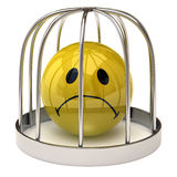 Smiley in a cage. Isolated on white background Royalty Free Stock Photos