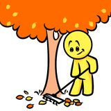 Smiley character autumn cleaning leaves tree Stock Photos