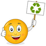 Smiley Character Holding Recycle Sign Royaltyfria Bilder