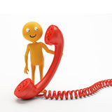 Smiley character phone Stock Images