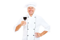 Smiley chef holding glass of wine Royalty Free Stock Photo