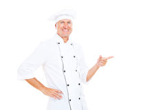 Smiley chef pointing at copyspace Stock Photo