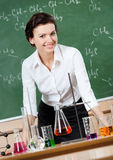 Smiley chemistry teacher Stock Images