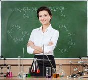 Smiley chemistry teacher Stock Photos