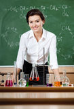 Smiley chemistry teacher Royalty Free Stock Images