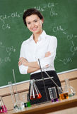 Smiley chemistry teacher with crossed arms Royalty Free Stock Image