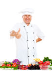 Smiley chief cook showing thumbs up Royalty Free Stock Photography