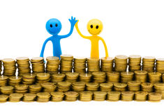Smiley and coins isolated Stock Images