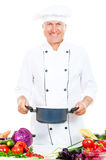 Smiley cook holding saucepan Stock Photos
