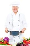 Smiley cook holding saucepan Stock Photos