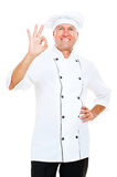 Smiley cook showing ok sign Stock Photo