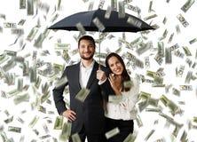 Smiley couple with black umbrella Stock Photos