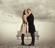Smiley couple flirting and embracing Royalty Free Stock Images