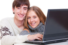 Smiley couple with laptop Stock Photos