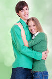 Smiley couple over green Royalty Free Stock Photo