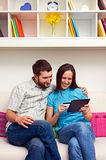 Smiley couple shopping on the internet Stock Images