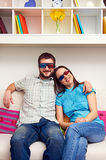 Smiley couple in stereo glasses Royalty Free Stock Photography